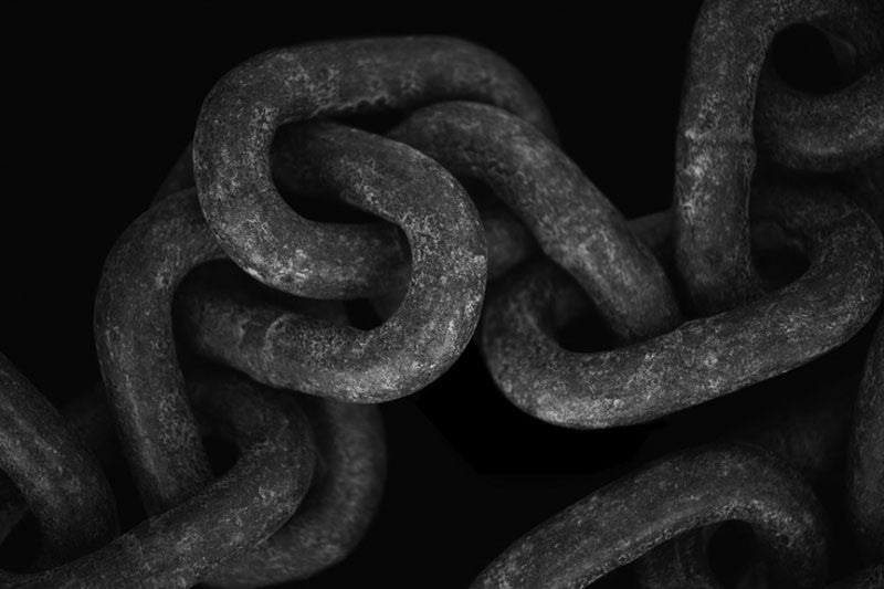 Black and white photograph of the links of a very large chain, found on the waterfront in St. Augustine, Florida.