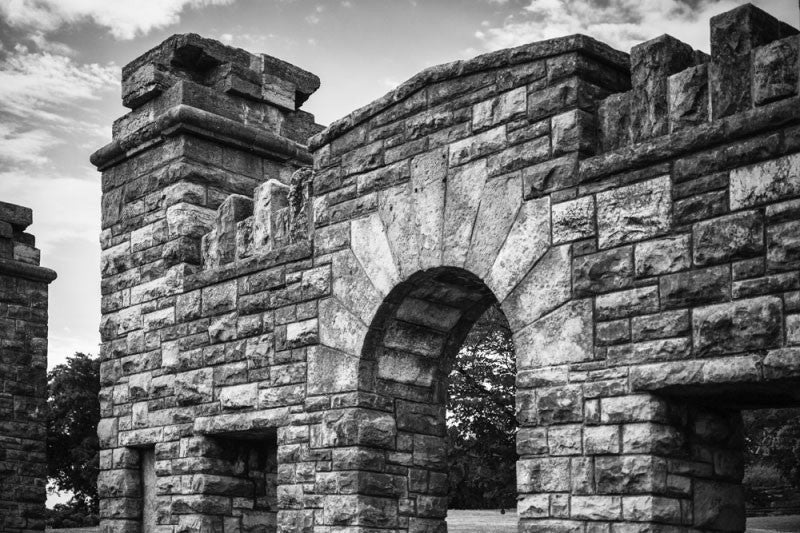 Black and white photograph of the old stone gate at the Fort Negley Civil War site in Nashville, Tennessee. Fort Negley is a star-shaped structure built of limestone blocks on a hilltop south of the city, and was the largest inland fort built during the American Civil War. The fort was built by the Union army in 1862 as a defensive post after the Confederates lost control of Nashville in successive battles, but with fighting concentrated in other areas, the fort never saw action.