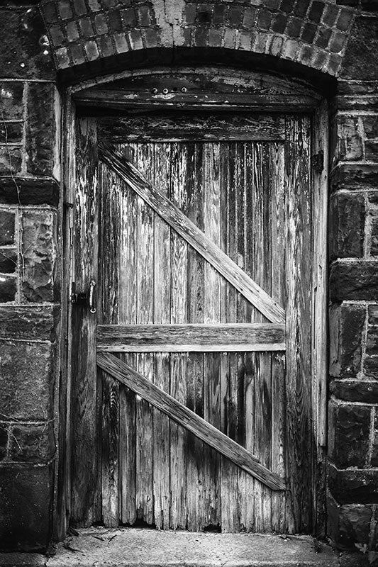 Black and white photograph of the wooden door to an abandoned industrial building located in downtown Birmingham, Alabama near Sloss Furnaces.