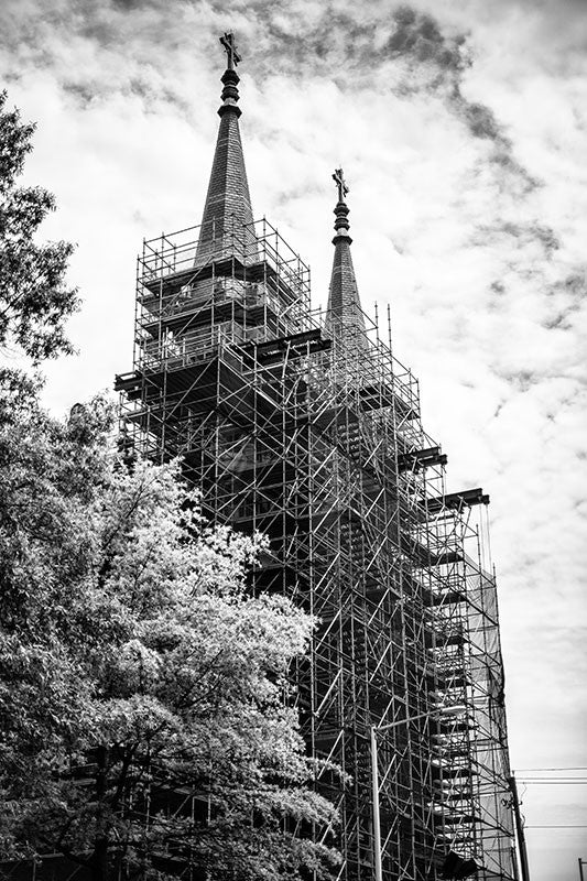 Black and white photograph of a church in downtown birmingham alabama surrounded by scaffolding