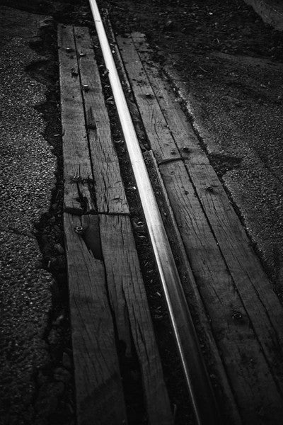 Black and white photograph of a shining railroad track in Birmingham, Alabama.