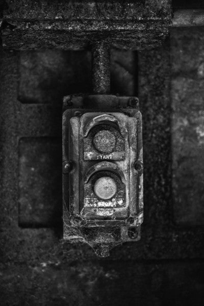 Black and white industrial photograph of a rusty and crusty start button at Sloss Furnaces in Birmingham, Alabama.