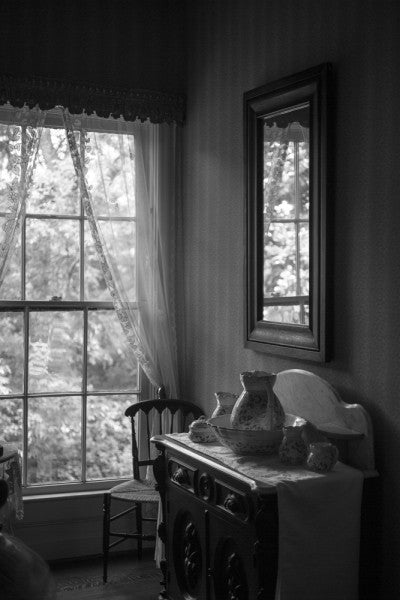 Black and white interior photograph of a bedroom inside Birmingham's historic Arlington House.