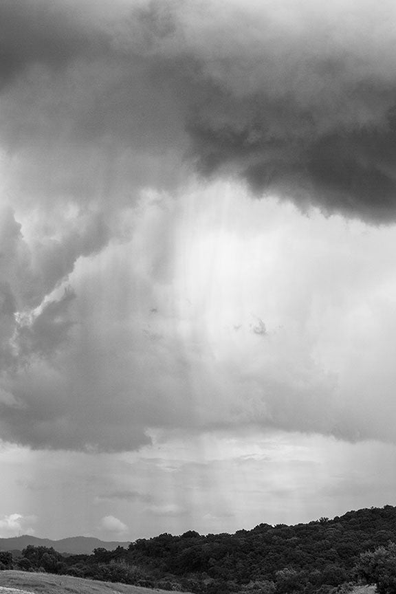 Black and white landscape photograph of a rain shower over the hills near historic Franklin, Tennessee, not far from Nashville.