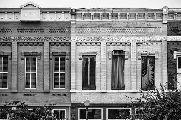 Black and white photograph of a row of historic storefronts around a southern small town courthouse square in Shelbyville, Tennessee