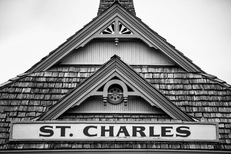 Black and white photograph of the St. Charles sign on the old train depot in the historic town of St. Charles, Missouri.