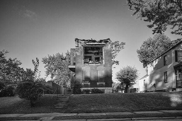 Black and white photograph of burned and abandoned row house in the College Hill neighborhood of St. Louis.