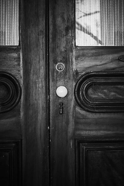 Black and white photograph of the wooden front doors of the beautiful and historic Chantillon-DeMenil Mansion in St. Louis, Missouri.