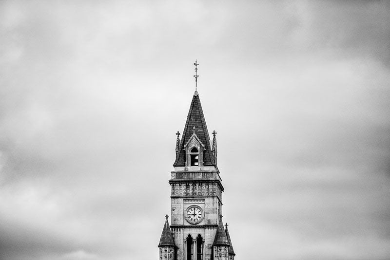 Black and white architectural photograph of the tower of the historic Customs House, framed alone against a dramatic sky, in downtown Nashville.