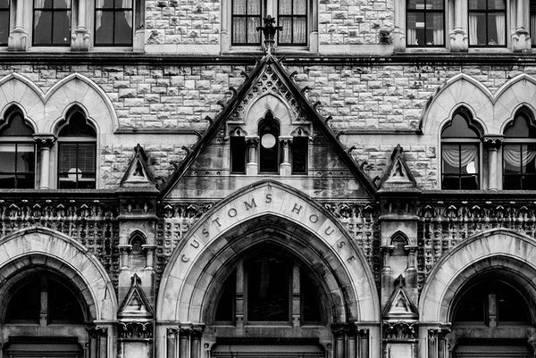 Black and white architectural photograph of the three arches and ornate stonework on the front of the Customs House on Broadway in Nashville.