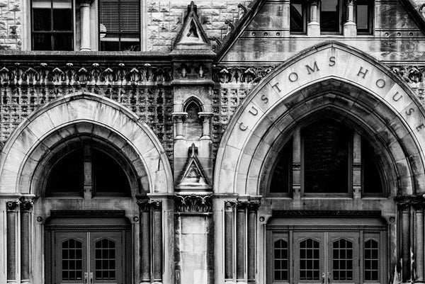 Black and white architectural photograph of the arches and ornate stonework on the front of the Customs House on Broadway in Nashville.