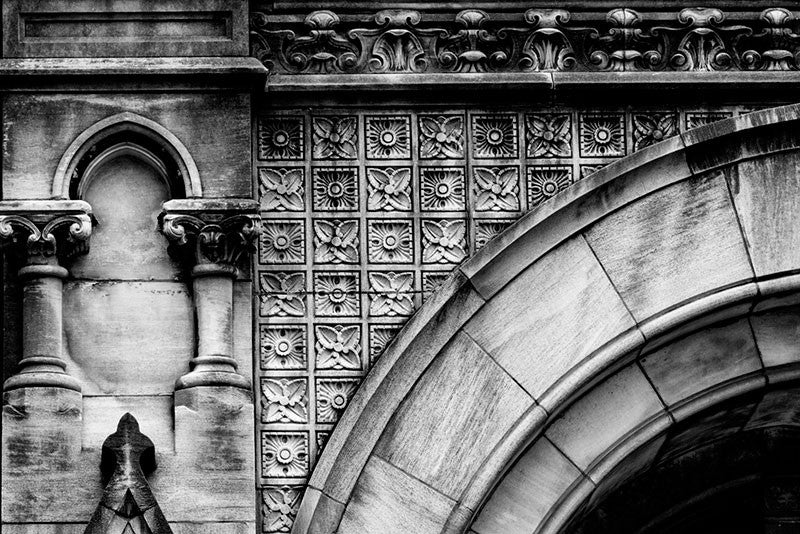 Black and white architectural detail photograph of an arch and ornate stonework on the front of the Customs House on Broadway in Nashville.