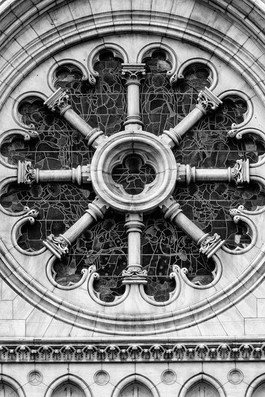Black and white architectural photograph of the large, round stained glass window on the exterior of the historic Christ Church in Nashville, Tennessee.