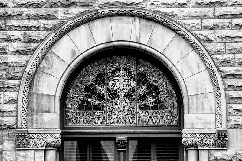 Black and white architectural detail photograph of an ornately decorated arched window on Nashville's historic Union Station.