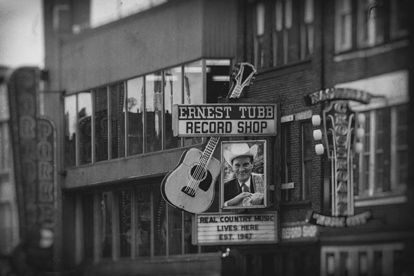 Black and white photograph of Nashville's Lower Broadway honky tonk district.