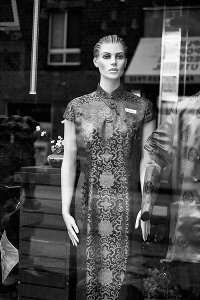 Black and white photograph of a store window display mannequin in Philadelphia's Chinatown.