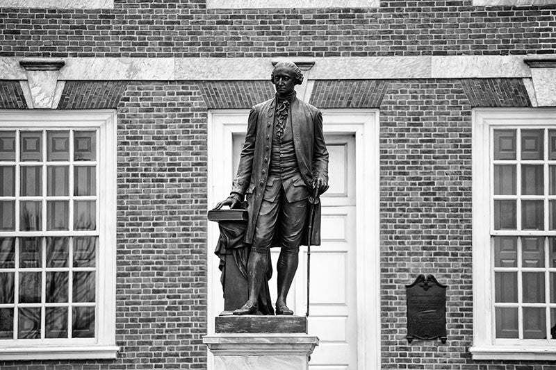 Black and white photograph of the statue of George Washington outside Independence Hall in Philadelphia.