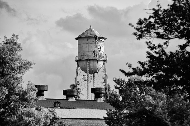 Black and white photograph of an old water tower in Lafayette, Louisiana.