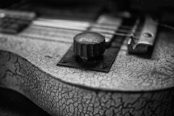 Black and white photograph of an old Cajun fiddle with cracked paint, found in the heart of Cajun country -- Lafayette, Louisiana.
