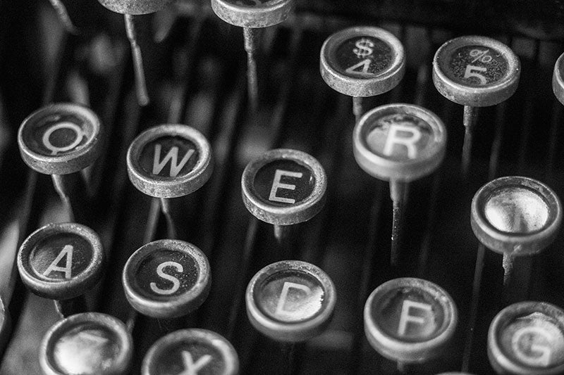 Black and white photograph of the keys of an antique Underwood typewriter.