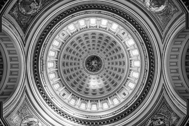 Black and white photograph looking up at the ornate interior dome inside the Wisconsin state house in Madison, Wisconsin.