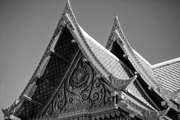 Black and white detail photograph of the distinct roof peaks on the ornate red and gold Thai Pavilion, at Olbrich Botanical Garden in Madison, Wisconsin.