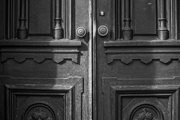 Black and white photograph of the historic wooden doors to Jubilee Hall, on the campus of Fisk University in Nashville, Tennessee.