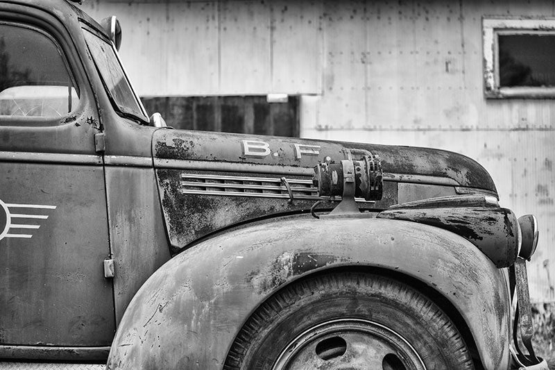 Black and white photograph of a faded red antique firetruck near Clarksdale, Mississippi.