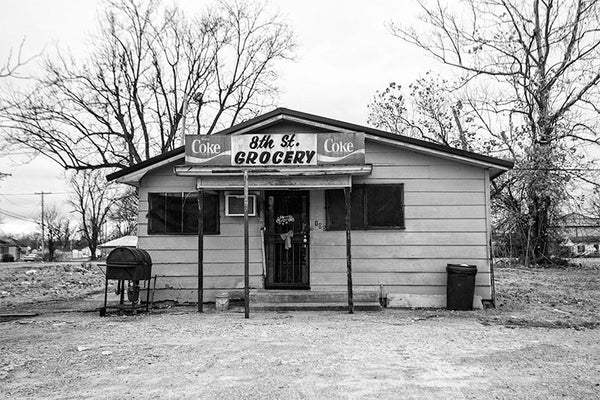 Black and white photograph of a small neighborhood store in downtown Clarksdale, Mississippi.