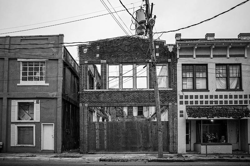 Black and white photograph of abandoned and collapsing buildings on 3rd Street in downtown Clarksdale, Mississippi.