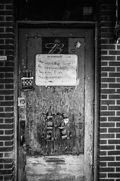 Black and white photograph of the door into Red's, a contemporary Delta blues juke joint in Clarksdale, Mississippi.