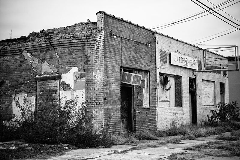 Black and white photograph of Smitty's Red Top Lounge, one of the great historic blues juke joints of the Mississippi Delta region, now abandoned and falling into ruin.