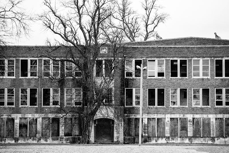 Black and white photograph of a huge, abandoned school building in Clarksdale, Mississippi.