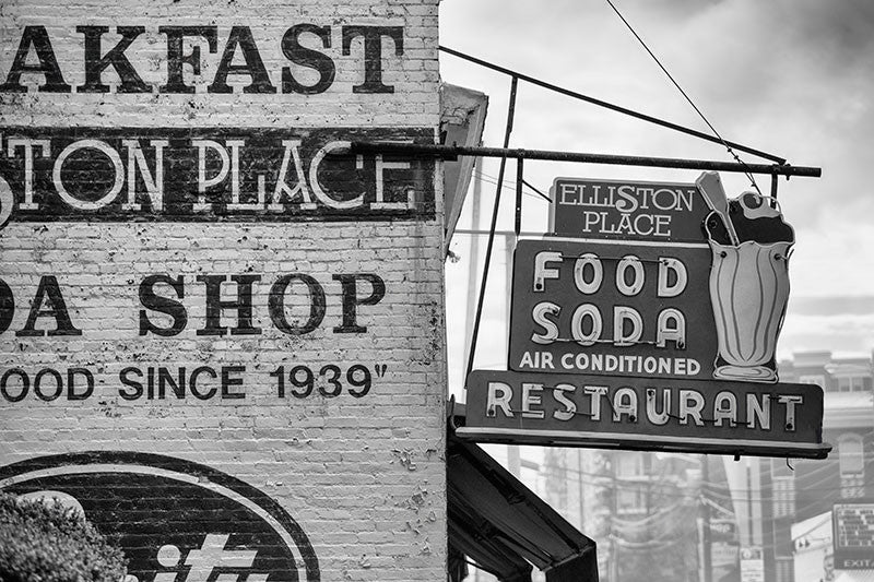 Black and white photograph of the vintage sign for Elliston Place Soda Shop in Nashville's West End.