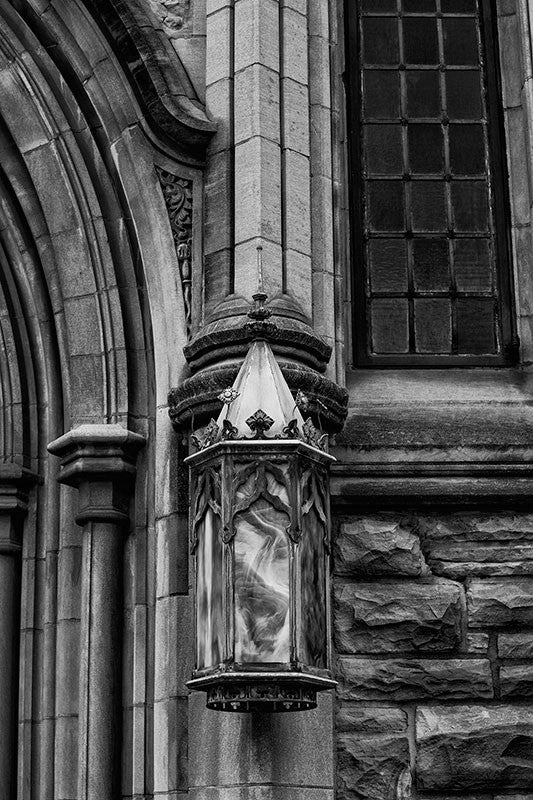Black and white architectural detail photograph of an ornate lamp on the exterior of a historic church in Nashville, Tennessee.