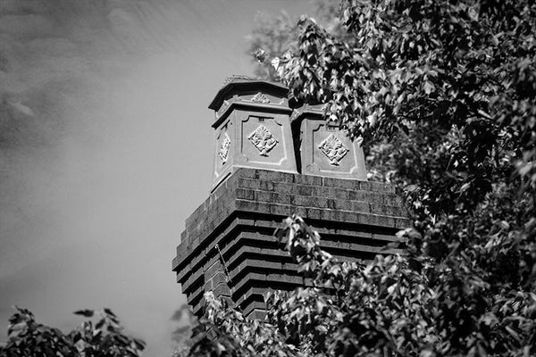 Black and white photograph of decorative chimneys on a historic home in Atlanta's leafy and eclectic Little Five Points neighborhood.