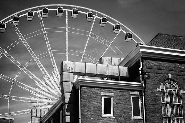 Black and white photograph of the giant white ferris wheel in downtown Atlanta, with the Tabernacle in the foreground.