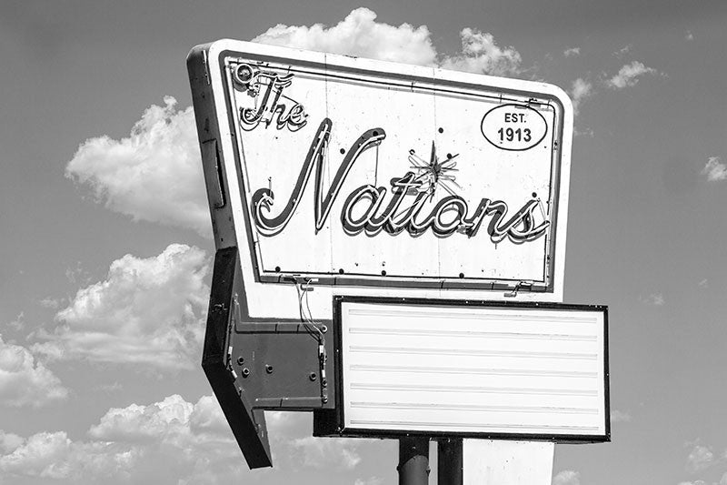 Black and white photograph of a vintage sign in The Nations, one of Nashville's oldest neighborhoods that's now up-and-coming in popularity.