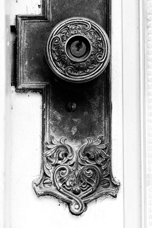 Black and white fine art photograph of a fancy door knob on a historic house in Houston, Texas.