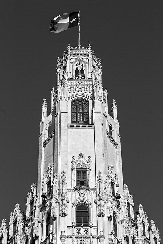 "Black and white fine art architectural photograph of The Emily Morgan Hotel in San Antonio, Texas. Built in 1924, originally to serve as a hospital, the iconic Gothic Revival building is now a hotel named after a heroine of Texas history, Emily Morgan (also known as Emily D. West), who was also the inspiration for the song ""The Yellow Rose of Texas."""