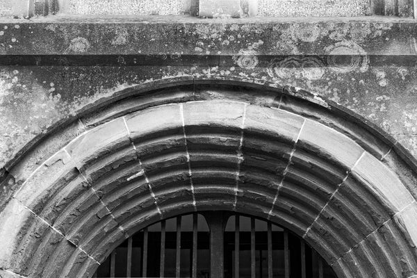 Black and white photograph of the repeated arches over the main entrance to the old Charleston County Jail, built in 1802 and in service until 1939.