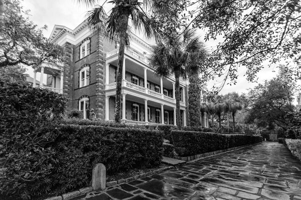 Black and white photograph of Charleston's Calhoun Mansion in the early morning after a rain shower, as seen from Meeting Street.
