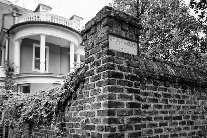 Black and white photograph of an ivy-covered wall on the corner of Meeting Street and Ropemaker's Lane in Charleston, South Carolina.