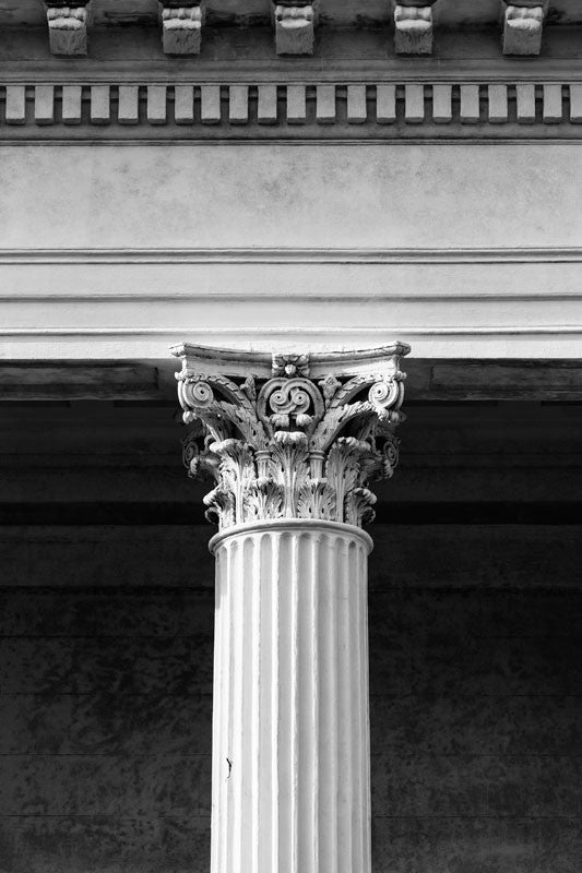 Black and white photograph of a classic Corinthian column on a historic building in Charleston, South Carolina.