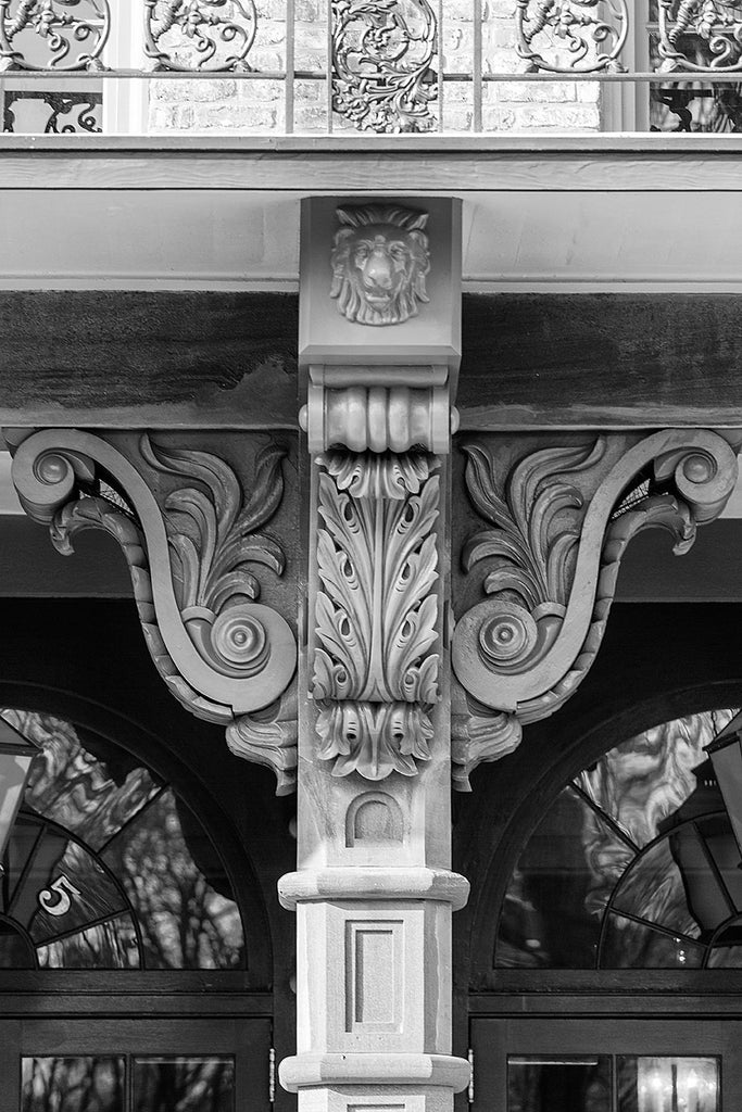 Black and white architectural detail photograph of beautiful, ornate wooden corbels on a historic building in Charleston.