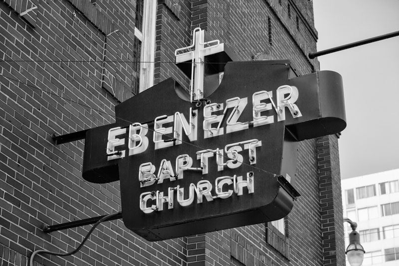 Black and white photograph of the sign for Martin Luther King's historic Ebenezer Baptist Church in Atlanta.