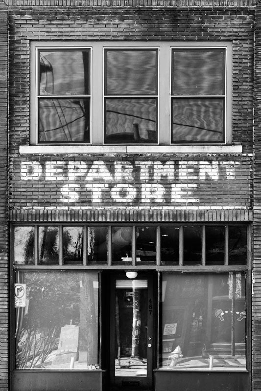 "Black and white photograph of an old store front with extant painted ""Department Store"" sign on the red bricks. This building is in the same Atlanta neighborhood as the Martin Luther King, Jr. birthplace and his former church. Perhaps Dr. King even shopped in this store."