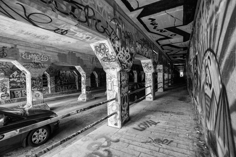 Black and white photograph of the famous krog street tunnel street art site in the cabbagetown