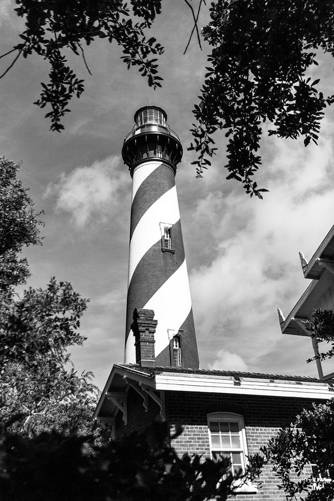 Black and white photograph of the St. Augustine lighthouse and the residence of the lighthouse keeper in St. Augustine, Florida. The current lighthouse stands at the north end of Anastasia Island and was built in 1874.