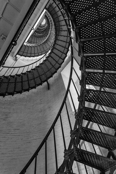 Black and white architectural photograph of the metal stairs spiraling upwards toward the top of the St. Augustine Lighthouse in St. Augustine, Florida.